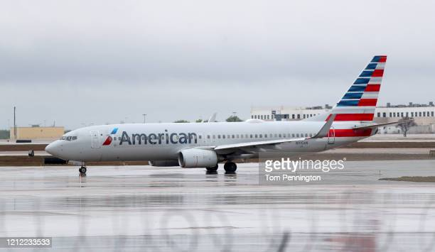View of an American Airlines jet at Dallas/Fort Worth International Airport on March 13, 2020 in Dallas, Texas. American Airlines announced that it...