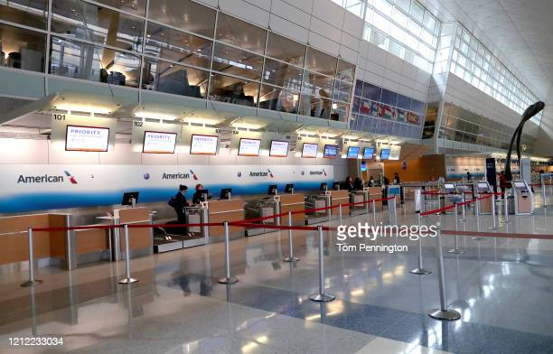 View of an American Airlines ticket counter in Terminal D at Dallas/Fort Worth International Airport on March 13, 2020 in Dallas, Texas. American...