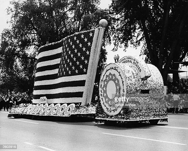 View of an American flag float during a US Bicentennial parade July 1976
