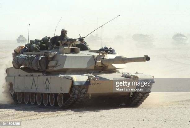 View of an American M1A1 Abrams tank as it crosses the desert during the Gulf War Iraq 1991 Other tanks are visible in the background