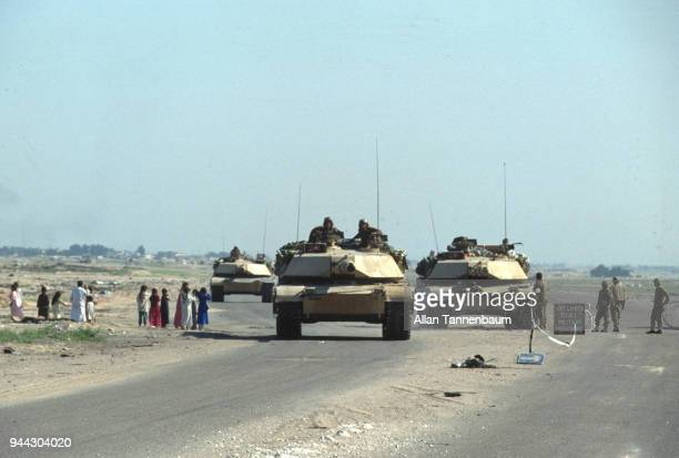 View of an American M1A1 Abrams tanks at a checkpoint during the Gulf War Iraq 1991