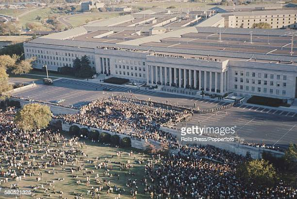 View of an anti Vietnam war demonstration with marchers advancing towards the Pentagon building the headquarters of the United States Department of...