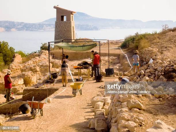 CONTENT] A view of an archeological site in the Peñon or Mountain of Ifach that it located in front of the coast city of Calpe