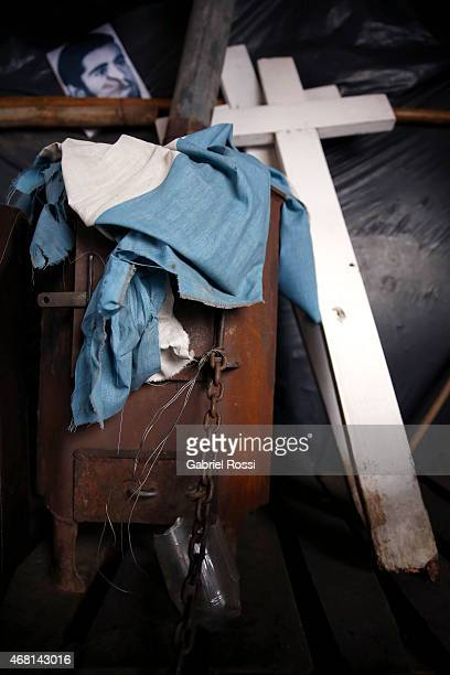 View of an Argentinian flag and crosses at the Continental Veterans Camp at Plaza de Mayo on March 27, 2015 in Buenos Aires, Argentina. Since 2008,...