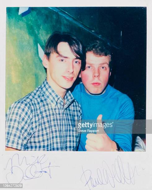 View of an autographed Polaroid photograph of English Rock and Pop musicians Paul Weller and Mick Talbot, both of the group the Style Council, 1985.