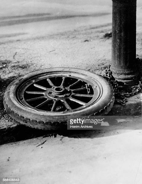 View of an automobile tire chained to a post New York April 14 1922 Utilizing the spare tire a thief had stolen the car