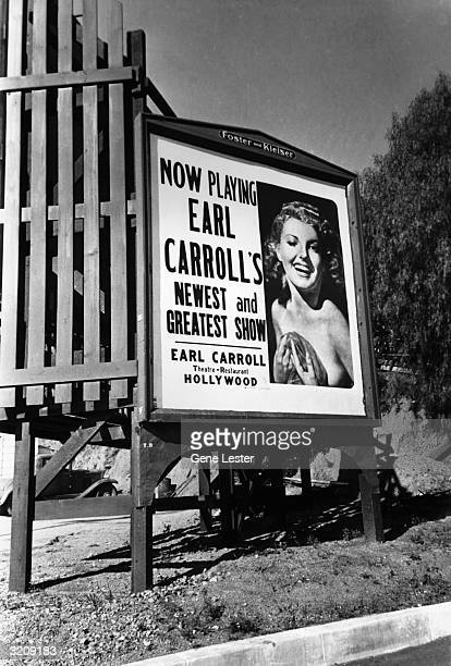 View of an Earl Carroll Theater billboard featuring a nude woman covering herself with a towel and winking Hollywood California