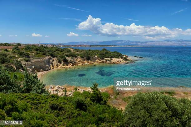 view of an empty beach in cesme. - emreturanphoto stock pictures, royalty-free photos & images
