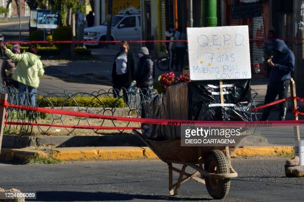 View of an empty coffin placed by relatives of a victim of COVID-19 who died a week ago to protest for not being able to bury him, in Cochabamba,...