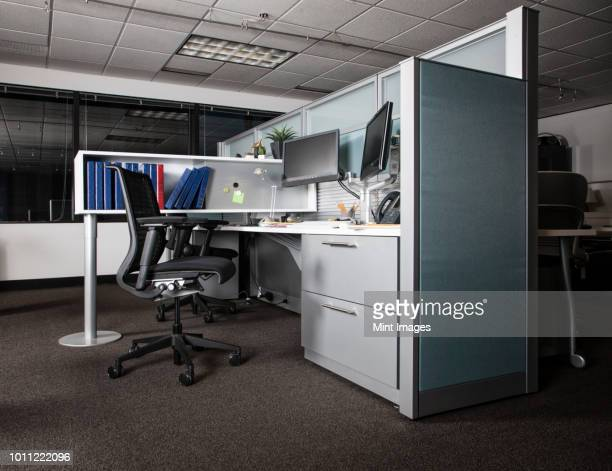 view of an empty cubicle office space at night. - office cubicle stock pictures, royalty-free photos & images
