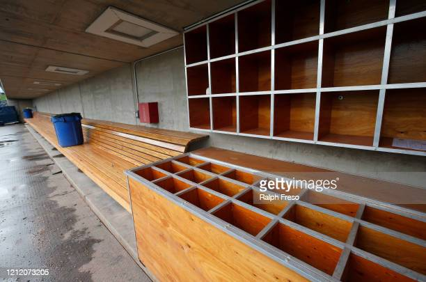 View of an empty dugout at American Family Fields stadium, spring training home of the Milwaukee Brewers, following Major League Baseball's decision...