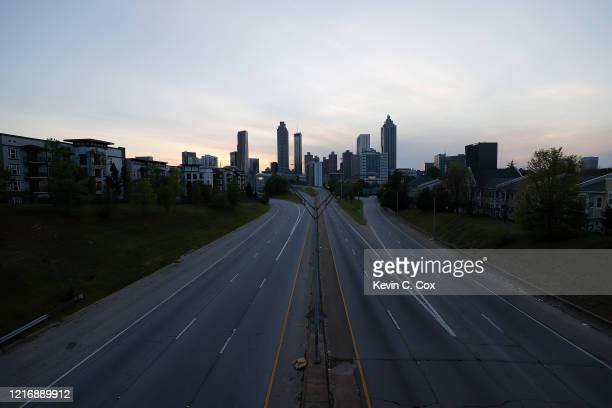 A view of an empty John Lewis Freedom Parkway into downtown Atlanta from Jackson Street Bridge on April 4 2020 in Atlanta Georgia Georgia Gov Brian...