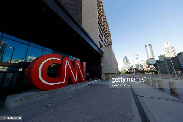 View of an empty sidewalk is seen outside of the CNN Center and the sign many tourists take pictures in front of on April 4, 2020 in Atlanta,...