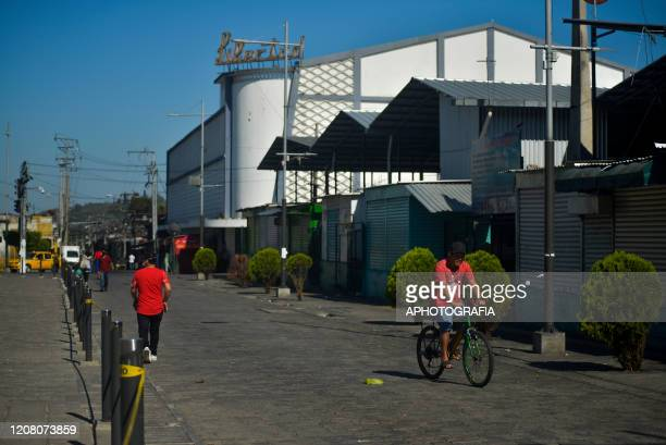 View of an empty street as people self quarantine to comply with the governments curfew on March 23 2020 in San Salvador El Salvador Three cases of...