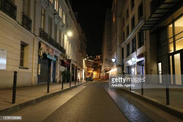 View of an empty street as the curfew starts within the scope of the coronavirus pandemic measures as the virus continue to spread in Paris, France...