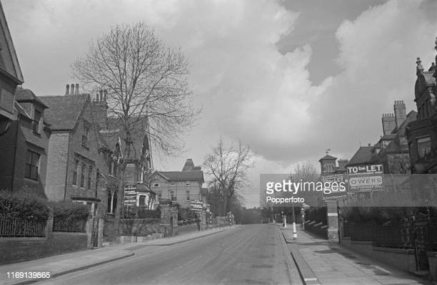 View of an empty street in Hampstead London showing a number of 'To Let' boards outside properties lining the road during World War II in April 1940...