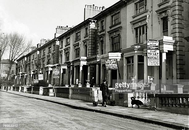 circa 1940 Great Britain Houses advertised to rent in the London suburb of Hampstead left empty because of evacuation to the country and people being...