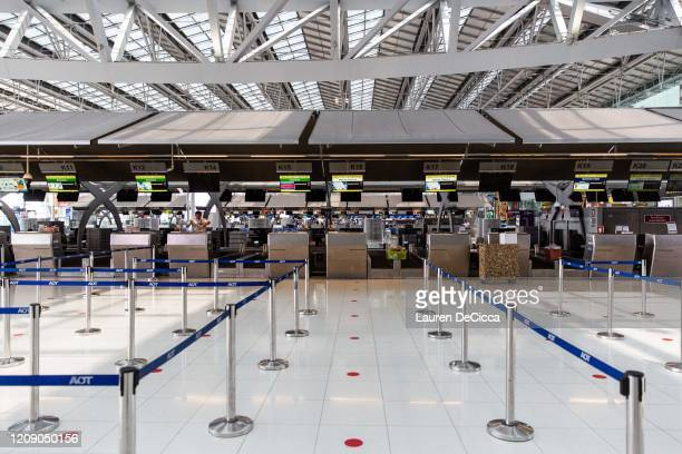 View of an empty Suvarnabhumi Airport departure hall after Thailand's government announced that the country would be suspending all international...