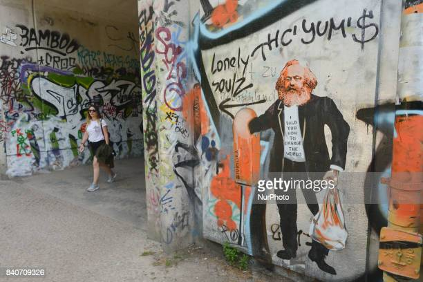 A view of an example of Berlin street art with graffiti of Karl Marx On Tuesday August 29 in Berlin Germany