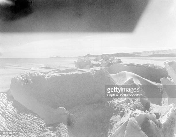 A view of an ice crack looking towards Cape Barne on Cape Evans photographed during the last tragic voyage to Antarctica by Captain Robert Falcon...