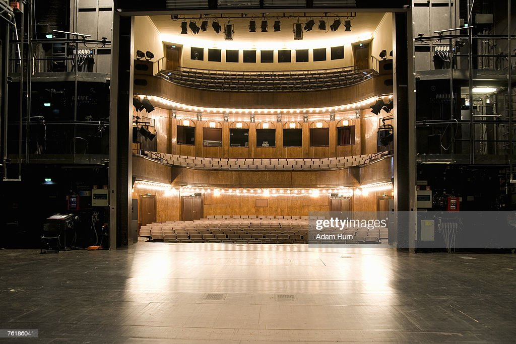 View of an illuminated art deco theater from backstage : Stock Photo
