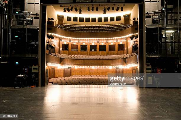view of an illuminated art deco theater from backstage - music style stock pictures, royalty-free photos & images