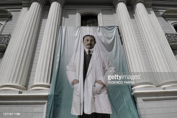 View of an image of Venezuelan doctor Jose Gregorio Hernandez outside La Candelaria church which holds his remains in Caracas on June 21 2020 Pope...