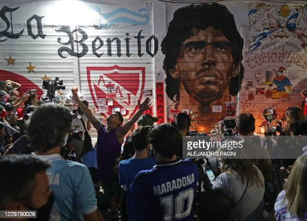 View of an improvised altar set up by Fans of Argentinos Juniors' football team, where Argentinian football legend Diego Maradona used to play,...