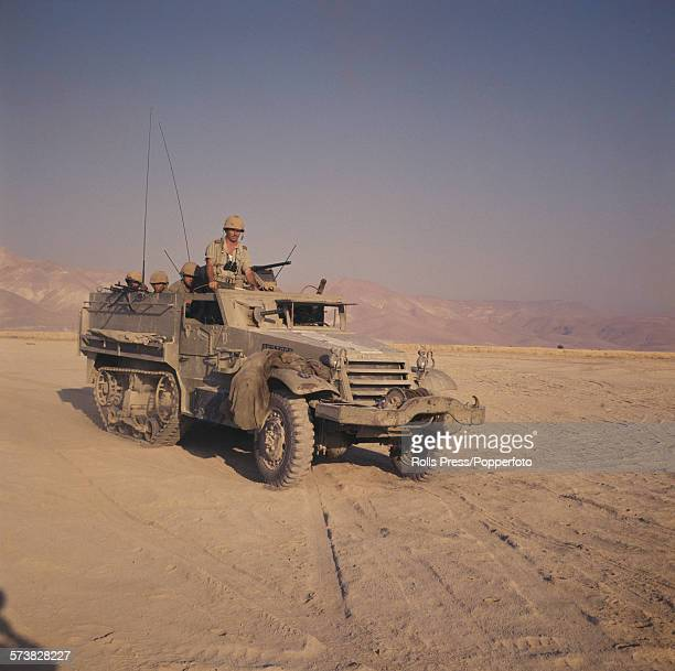 View of an Israel Defense Forces M3 Halftrack armoured personnel carrier in action in a desert region during the Six Day War conflict between Israel...