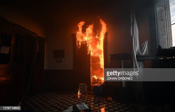 View of an office of the Congress building set on fire by demonstrators during a protest demanding the resignation of President Alejandro Giammattei,...