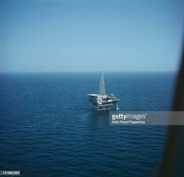 View of an oil rig in the Persian Gulf off the coast of Iran exploration drilling for oil and gas in the sea offshore in November 1971