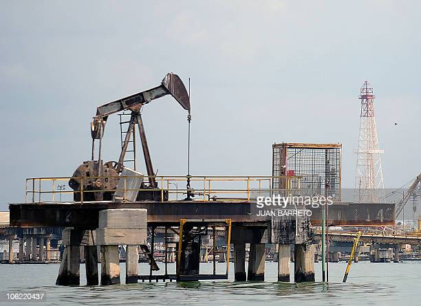 View of an oil rocker in Maracaibo Lake in the border state of Zulia in western Caracas on October 27 2010 AFP PHOTO/Juan BARRETO