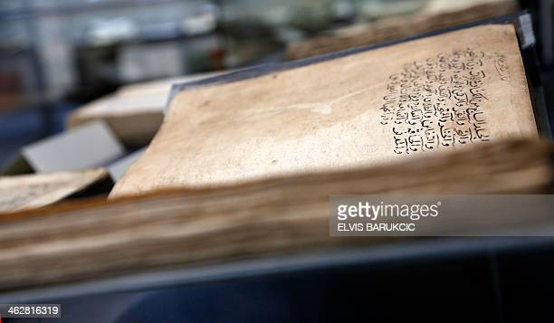 A view of an old manuscript on display during the reopening ceremony of the Gazi Husrevbey library in Sarajevo on January 15 2014 Bosnia opened today...