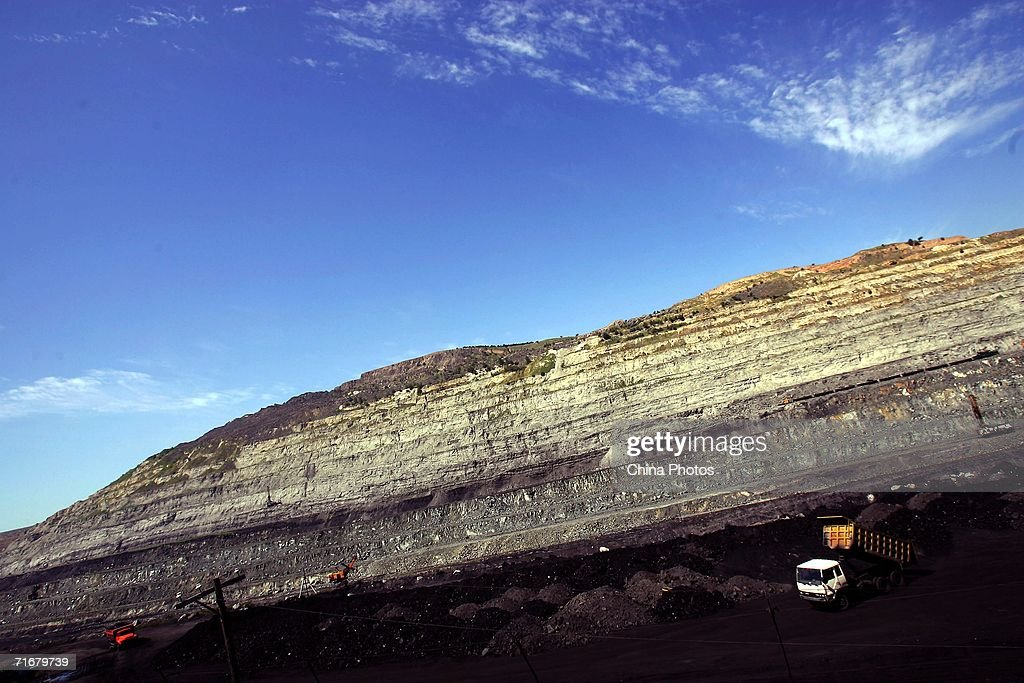 A view of an open pit coal mine is seen on August 19, 2006 in Chifeng of Inner Mongolia Autonomous Region, China.Pingzhuang Coal Groups Company, including six open pit coal mines, produces 10 million tons per year. Reportedly, in the first four months of this year, China's coal consumption rose by 13.8 percent over the same period of last year, and coal price is expected to go up steadily with the factors of environment, safety and resources included in the cost of coal production.