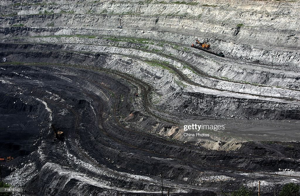 A view of an open pit coal mine is seen on August 19, 2006 in Chifeng of Inner Mongolia Autonomous Region, China. Pingzhuang Coal Groups Company, including six open pit coal mines, produces 10 million tons per year. Reportedly, in the first four months of this year, China's coal consumption rose by 13.8 percent over the same period of last year, and coal price is expected to go up steadily with the factors of environment, safety and resources included in the cost of coal production.