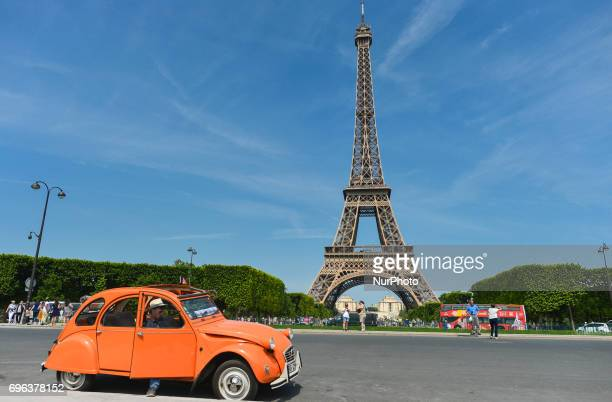 A view of an original Citroen 2CV parked in front of Eiffel Tower in Paris On Thursday June 15 in Paris France