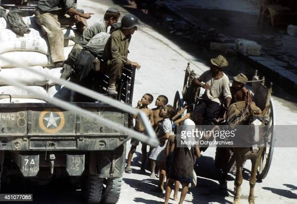 A view of an Sicilian children greeting Allied troops after the invasion of Sicily called Operation Husky during the World War II in Palermo Sicily...