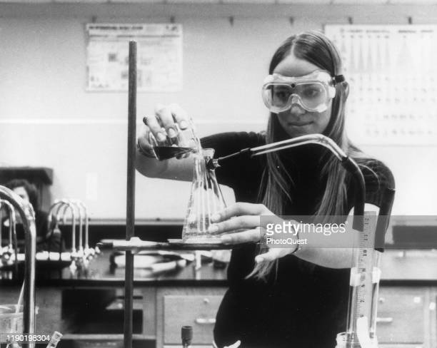 View of an unidentified chemistry student at work in a lab at Chabot College Hayward California 1979