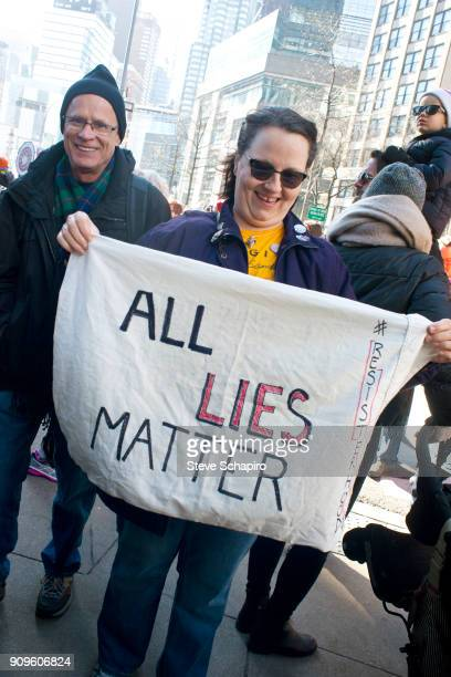 View of an unidentified demonstrator at the Women's March on New York New York January 20 2018 She holds a sign that reads 'All Lies Matter'