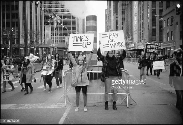 View of an unidentified demonstrators on Sixth Avenue during the Women's March on New York New York New York January 20 2018 They hold signs that...