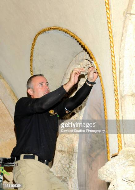 View of an unidentified employee touches up 'gold leaf' paint an arch at the MaraLago estate Palm Beach Florida March 11 2015
