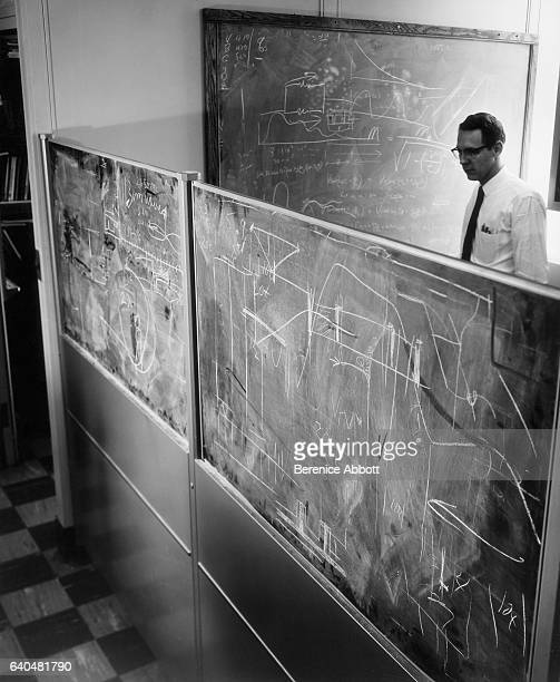 View of an unidentified engineer as he works on a series of blackboards at the IBM laboratory late 1950s Between 1958 and 1961 Abbott worked for the...