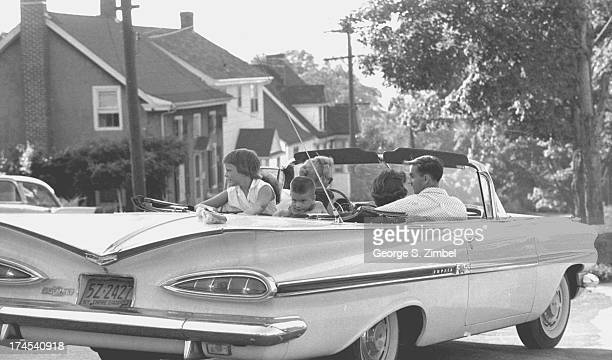 View of an unidentified family as the drive away in a Chevrolet Impala convertible New York 1960s