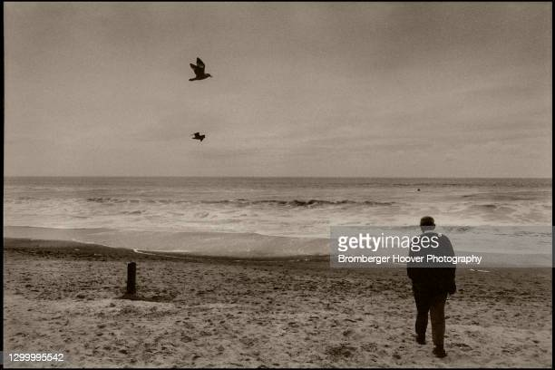 View of an unidentified man as he walks on the sand at Stinson Beach, Marin County, California, 1993.