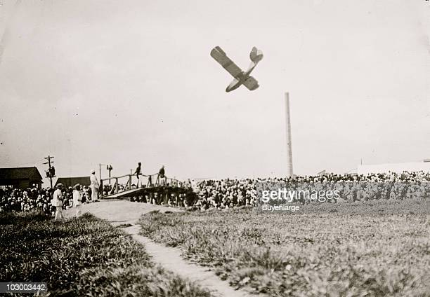 View of an unidentified monowing plane seeimingly about to crash at a wellpopulated air show early twentieth century The original caption refers to...