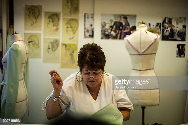 View of an unidentified seamstress in the Chanel atelier as she works on one of Karl Lagerfeld's designs for his fashion show Paris France 2010