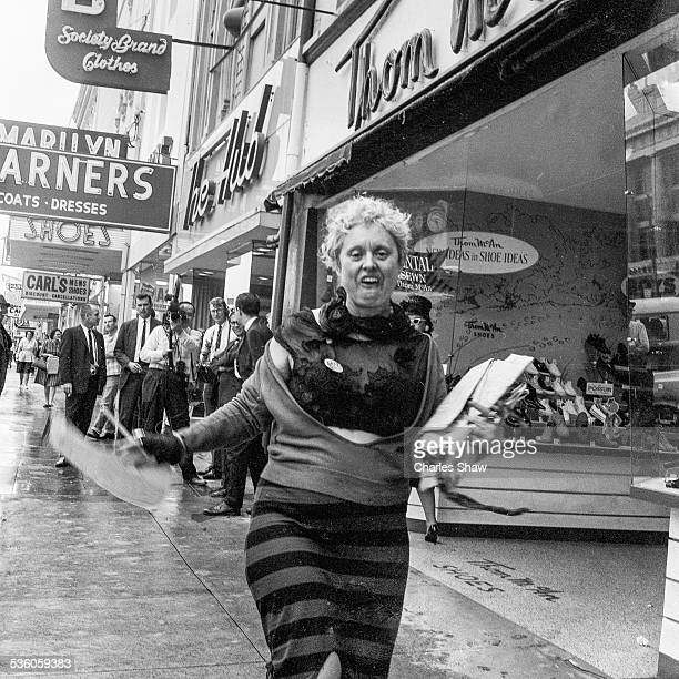 View of an unidentified woman approaches the camera on Dexter Avenue on the day before the Selma to Montgomery March arrived at the Alabama State...