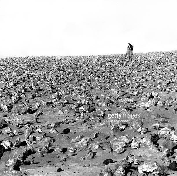 View of an unidentified woman as she stands alone in a salt desert, Arica, Tarapaca Region, Chile, December 1970.