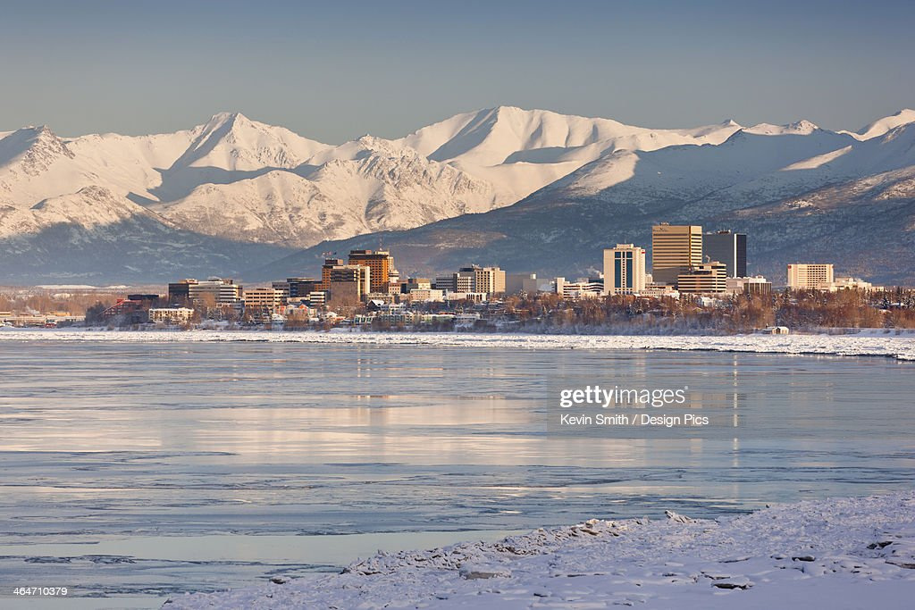 View Of Anchorage Skyline Chugach Mountains And Cook Inlet From Earthquake Park In Winter : Stock Photo