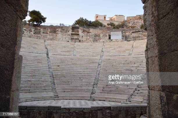view of ancient amphitheater - amphitheatre stock photos and pictures